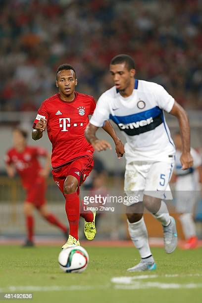 Julian Green of FC Internazionale challenges Juan Jesus of FC Bayern Muenchen during the international friendly match between FC Bayern Muenchen and...