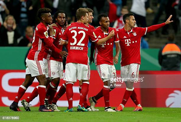 Julian Green of Muenchen celebrate with his team mates after he scores the 2nd goal during the DFB Cup second round match between Bayern Muenchen and...