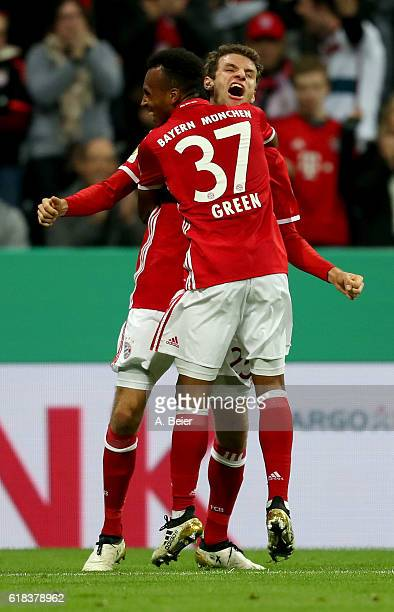Julian Green of Muenchen celebrate with team mate Thomas Mueller after he scores the 2nd goal during the DFB Cup second round match between Bayern...