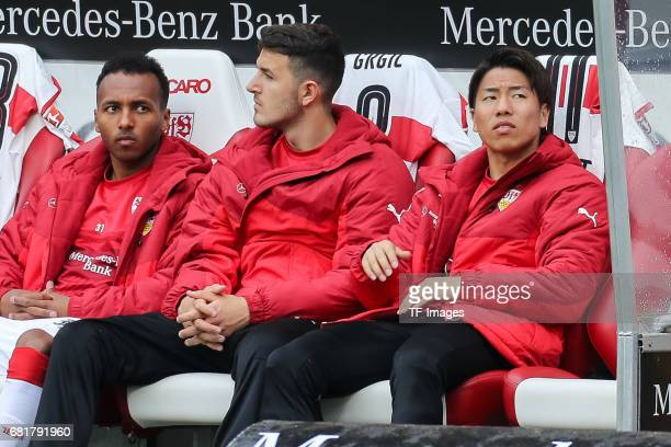 Julian Green of Stuttgart Anto Grgic of Stuttgart and Takuma Asano of Stuttgart sits on the bench during the Second Bundesliga match between VfB...
