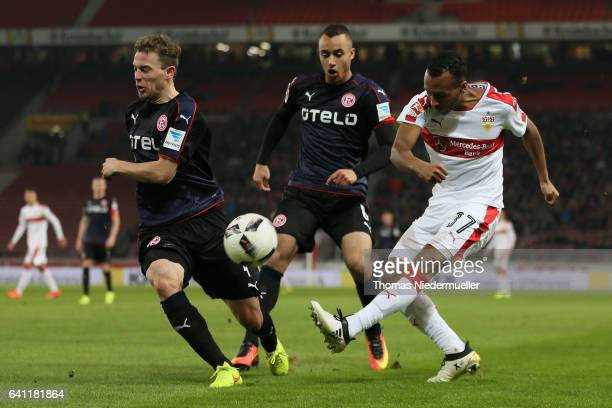 Julian Green of Stuttgart fights for the ball with Julian Schauerte and Jerome Kisewetter of Duesseldorf during the Second Bundesliga match between...