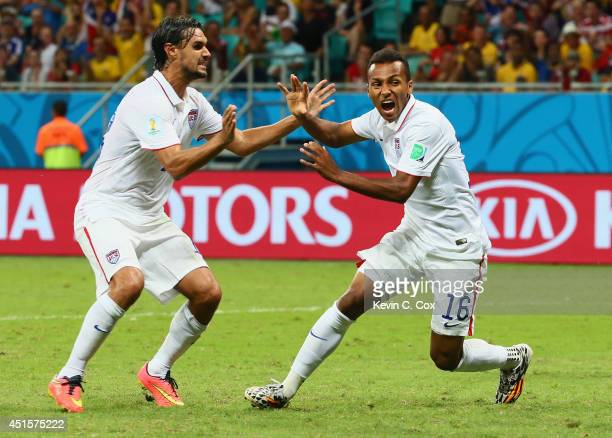 Julian Green of the United States celebrates scoring his team's first goal in extra time with Chris Wondolowski during the 2014 FIFA World Cup Brazil...