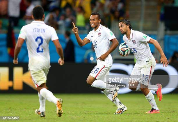 Julian Green of the United States celebrates scoring his team's first goal with his teammates DeAndre Yedlin and Chris Wondolowski during the 2014...