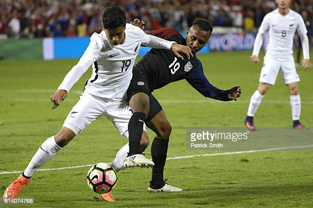 Julian Green of United States and Moses Dyer of New Zealand battle for control of the ball in the second half during an International Friendly at RFK...