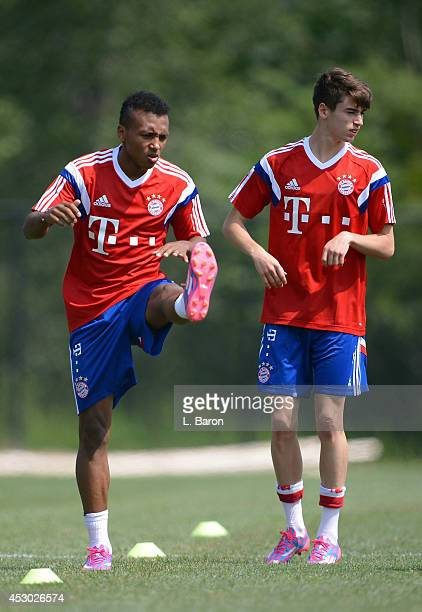 Julian Green warms up next to Lucas Scholl during a training session on day three of the Audi Summer Tour USA 2014 at Montclair University on August...