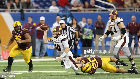 Julian Huff of the Minnesota Golden Gophers pressures quarterback Cooper Rush of the Central Michigan Chippewas in the fourth quarter leading to an...