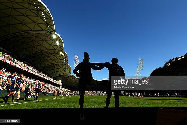 Julian Huxley and Nick Phipps of the Rebels warm up during the round four Super Rugby match between the Melbourne Rebels and the Cheetahs at AAMI...
