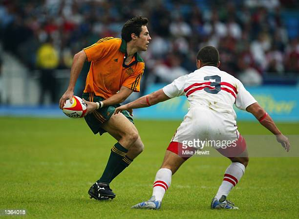 Julian Huxley of Australia takes on England's Henry Paul during the Men's Rugby 7's at the City of Manchester Stadium during the 2002 Commonwealth...
