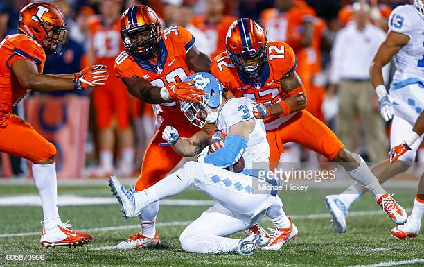 Julian Hylton and Chris James of the Illinois Fighting Illini tackle Ryan Switzer of the North Carolina Tar Heels at Memorial Stadium on September 10...