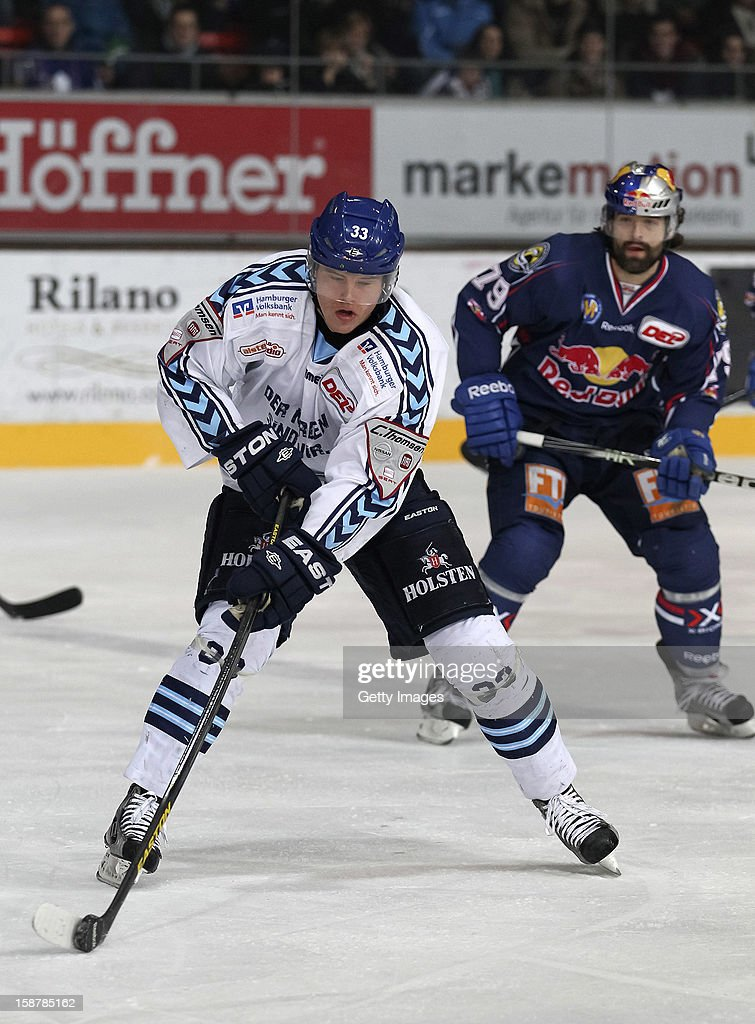 Julian Jakobsen (L) of Hamburg Freezers in action during the DEL ice hockey game between EHC Red Bull Munich and Hamburg Freezer at Olympia Eishalle on December 28, 2012 in Munich, Germany.