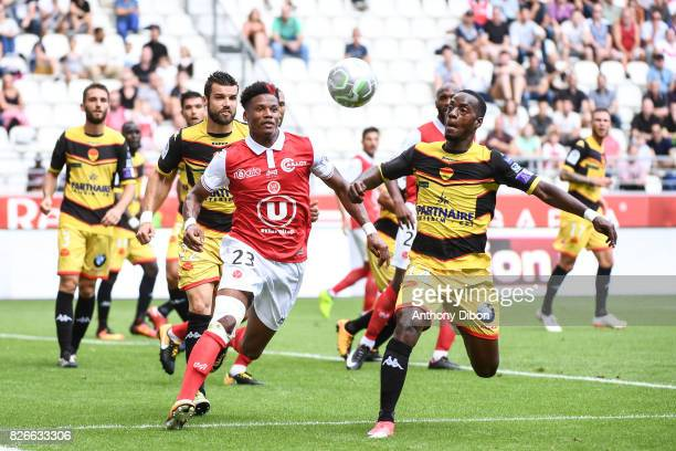 Julian Jeanvier of Reims and Arthur Gomis of Orleans during the French Ligue 2 match between Reims and Orleans at Stade Auguste Delaune on August 5...