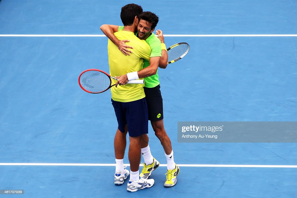 Julian Knowle of Austria shares a hug with Marcelo Melo of Brazil after winning the doubles final against Alexander Peya of Austria and Bruno Soares of Brazil during day six of the Heineken Open at ASB Tennis Centre on January 11, 2014 in Auckland, New Zealand.