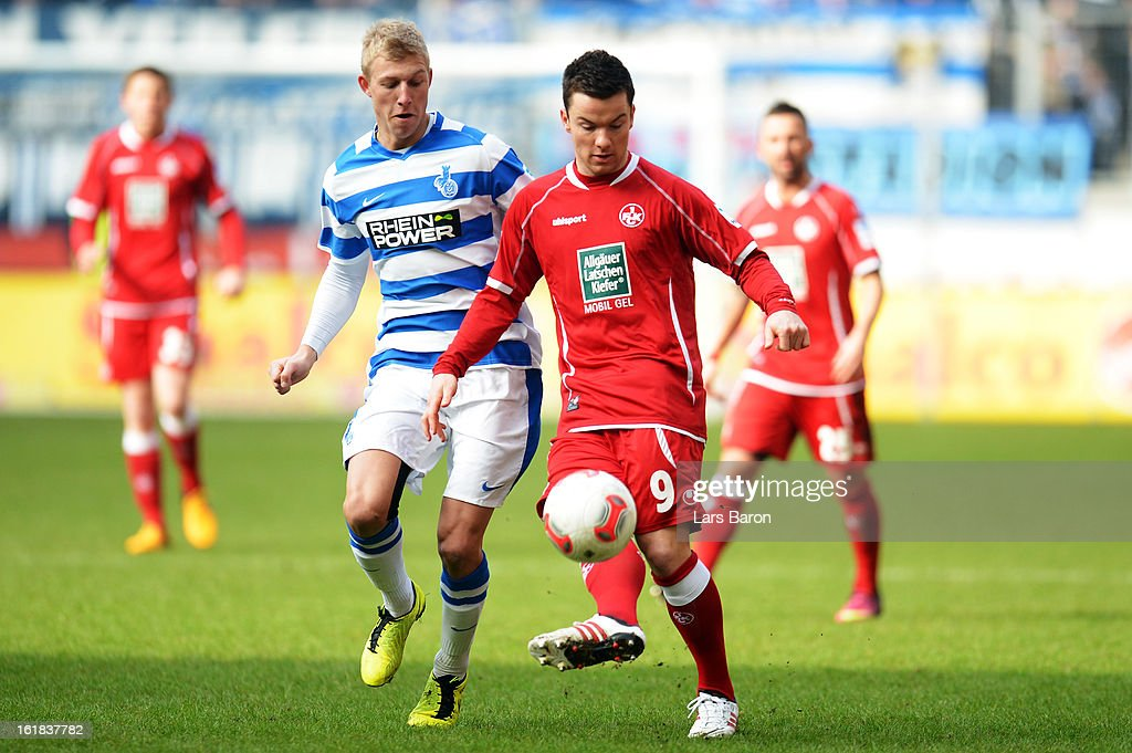 Julian Koch of Duisburg challenges Alexander Baumjohann of Kaiserslautern during the Second Bundesliga match between MSV Duisburg and 1. FC Kaiserslautern at Schauinsland-Reisen-Arena on February 17, 2013 in Duisburg, Germany.