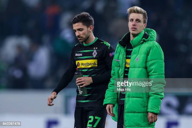 Julian Korb and Patrick Herrmann of Moenchengladbach react after the UEFA Europa League Round of 32 first leg match between Borussia Moenchengladbach...