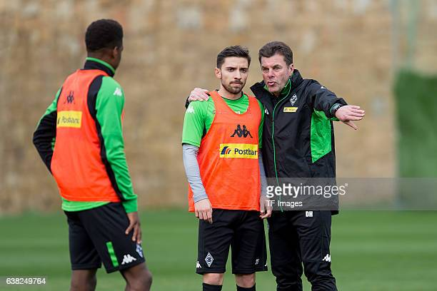 Julian Korb of Borussia Moenchengladbach and Head couch Dieter Hecking of Borussia Moenchengladbach during a Training Session at Borussia...