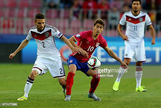 Julian Korb of Germany and Filip Djuricic of Serbia battle for the ball during the UEFA European Under21 Group A match between Germany and Serbia at...