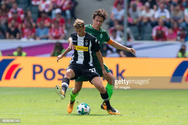 Julian Korb of Gladbach und Thomas Delaney of Bremen battle for the ball during the Telekom Cup 2017 match between Borussia Moenchengladbach and...