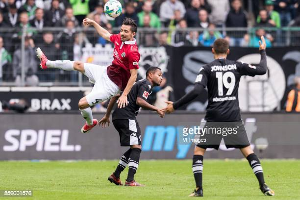 Julian Korb of Hannover 96 Raffael of Borussia Monchengladbach Fabian Johnson of Borussia Monchengladbach during the Bundesliga match between...