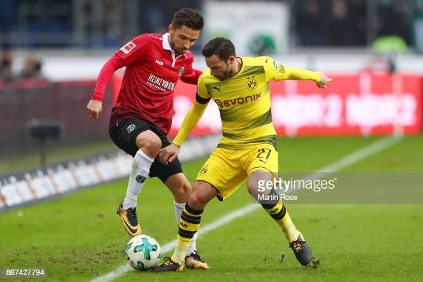 Julian Korb of Hannover fights for the ball with Gonzalo Castro of Dortmund during the Bundesliga match between Hannover 96 and Borussia Dortmund at...