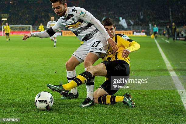 Julian Korb of Moenchengladbach and Christian Pulisic of Dortmund battle for the ball during the Bundesliga match between Borussia Dortmund and...