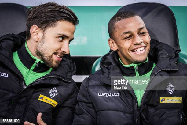 Julian Korb of Moenchengladbach and Djibril Sow sit on the bench prior the DFB Cup semi final match between Borussia Moenchengladbach and Eintracht...
