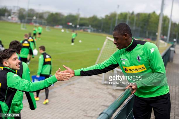 Julian Korb welcomes Mamadou Doucoure during a rehab training session at BorussiaPark on May 03 2017 in Moenchengladbach Germany