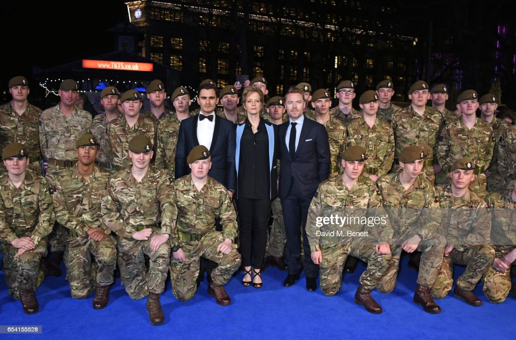 Julian Kostov, Jenny Seagrove and Ronan Keating pose with The Grenadier Guards and Scots Guards in support of the Armed Forces Fund at the World Premiere of 'Another Mother's Son' on March 16, 2017 in London, England.