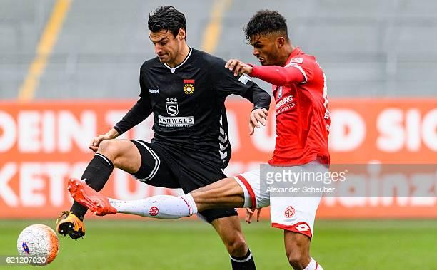 Julian Leist of Grossaspach challenges Aaron Seydel of Mainz 05 during the Third League match between 1 FSV Mainz 05 II and SG Sonnenhof Grossaspach...