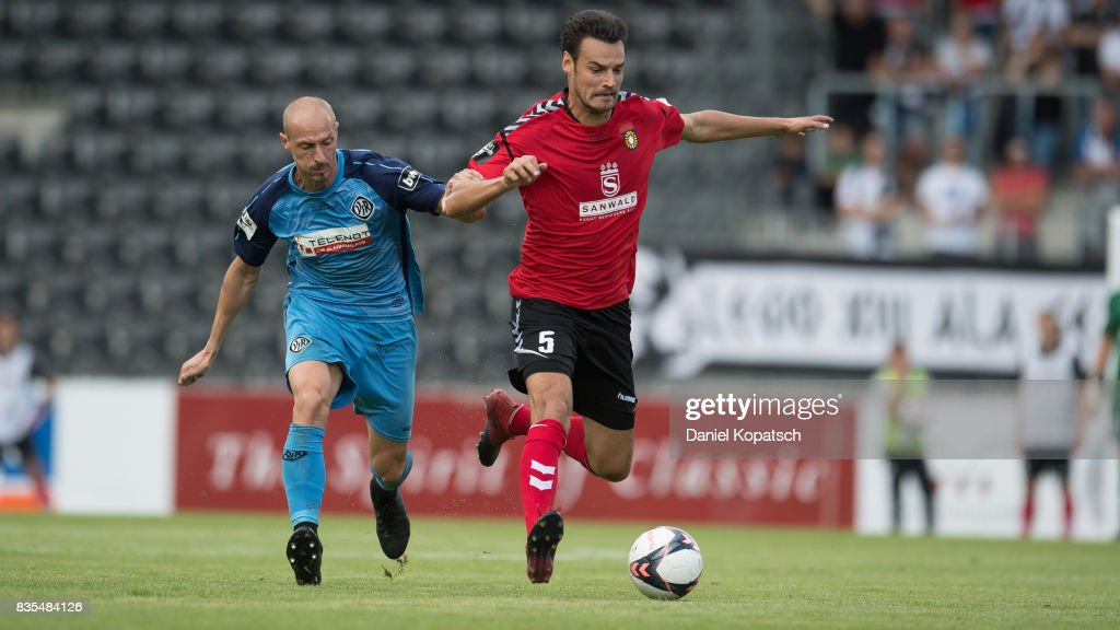 Julian Leist of Grossaspach (R) is challenged by Matthias Morys of Aalen during the 3. Liga match between SG Sonnenhof Grossaspach and VfR Aalen at on August 19, 2017 in Grossaspach, Germany.