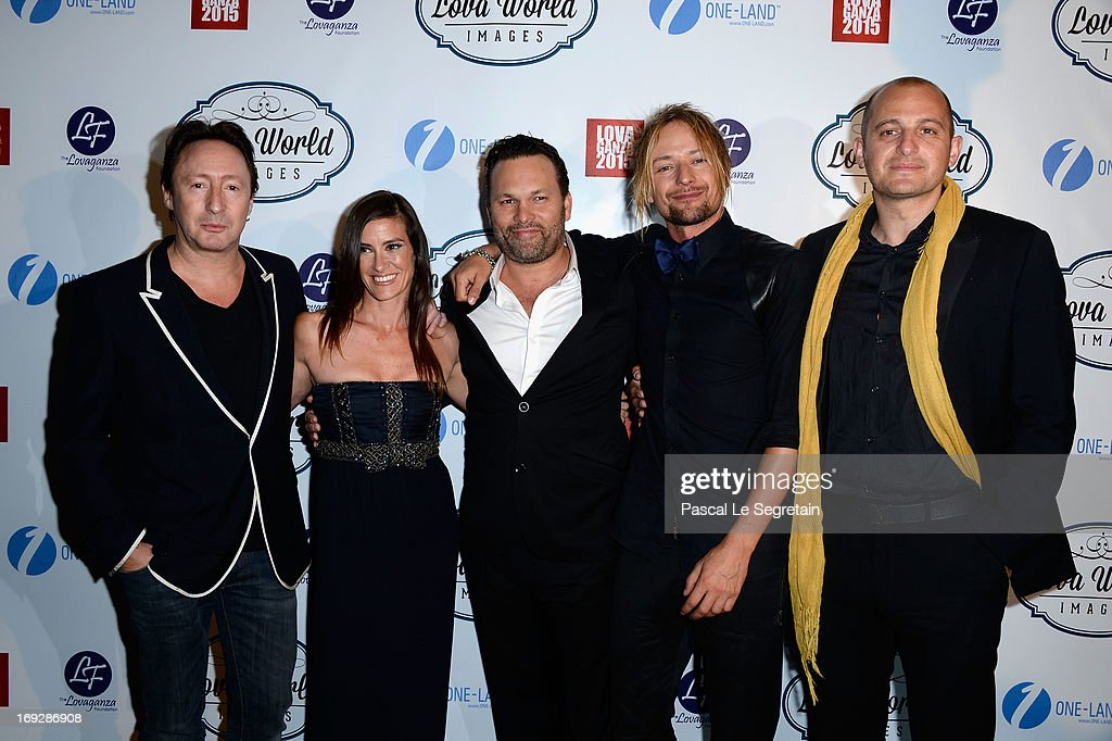 <a gi-track='captionPersonalityLinkClicked' href=/galleries/search?phrase=Julian+Lennon&family=editorial&specificpeople=211480 ng-click='$event.stopPropagation()'>Julian Lennon</a> (L) and Lucie Laurier (2L) attend the Lova World Images Closing Party during the 66th Annual Cannes Film Festival at Baoli Beach on May 22, 2013 in Cannes, France.