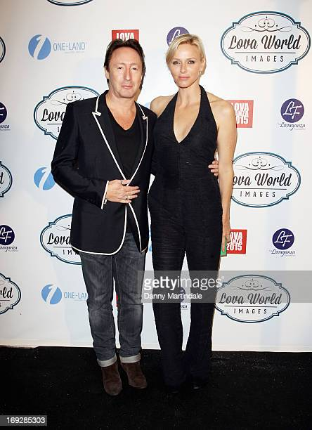 Julian Lennon and Princess Charlene of Monaco attend Lova World Images party during the 66th Annual Cannes Film Festival at Baoli Beach on May 22...