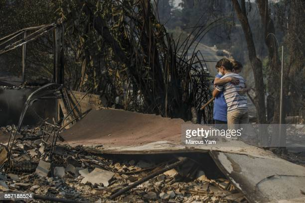 Julian Lipscomb is comforted by his mother Colette Lipscomb as they look at the damage to their home on December 6 2017 in Ventura California