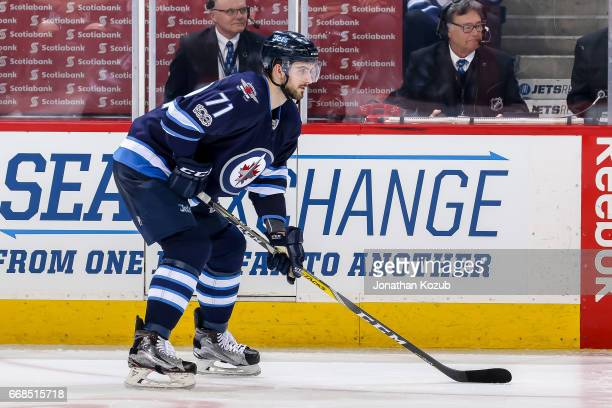 Julian Melchiori of the Winnipeg Jets gets set during a third period faceoff against the Nashville Predators at the MTS Centre on April 8 2017 in...