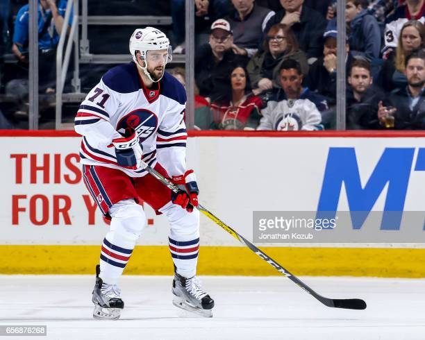 Julian Melchiori of the Winnipeg Jets keeps an eye on the play during second period action against the Minnesota Wild at the MTS Centre on March 19...