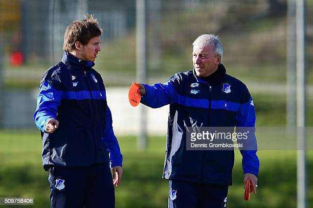 Julian Nagelsmann new head coach of TSG 1899 Hoffenheim exchanges words with assistant coach Armin Reutershahn during a training session on February...