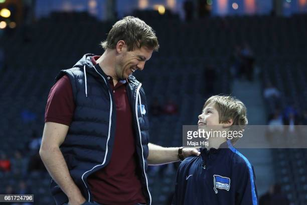 Julian Nagelsmann of Hoffenheim talks to ball boy Elias prior to the Bundesliga match between Hertha BSC and TSG 1899 Hoffenheim at Olympiastadion on...
