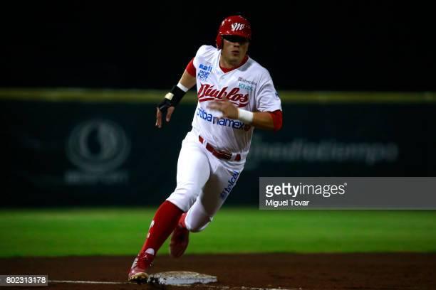 Julian Ornelas of Diablos runs the third base during the match between Rojos del Aguila and Diablos Rojos as part of the Liga Mexicana de Beisbol...