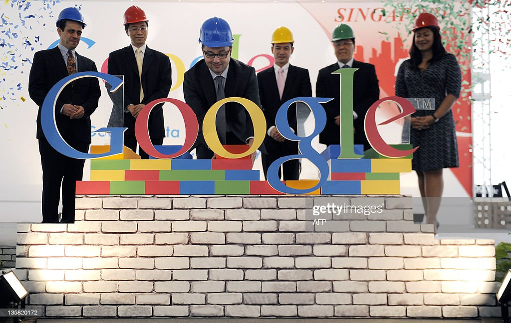 Julian Persaud (C), managing director of Google Southeast Asia, completes the Google letters on stage at a press conference on December 15, 2011. The ceremony marks the start of Google's construction of a 2.45-hectare data centre in the western part of Singapore, also the first in Southeast Asia, which will provide Google users in Singapore and Asia with faster and more reliable access to its services. AFP PHOTO / SIMIN WANG