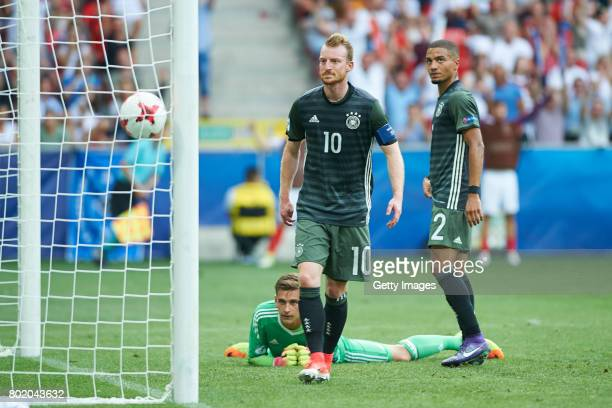 Julian Pollersbeck Maximilian Arnold and Jeremy Toljan of Germany after the goal for England during the UEFA European Under21 Championship Semi Final...