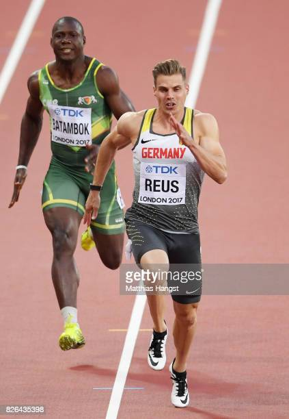 Julian Reus of Germany and Jean Tarcicius Batambok of Cameroon competes in the Men's 100 metres heats during day one of the 16th IAAF World Athletics...