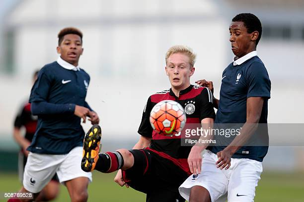 Julian Rieckmann of France challenges Till Cisskho of Germany during the UEFA Under16 match between U16 France v U16 Germany on February 6 2016 in...