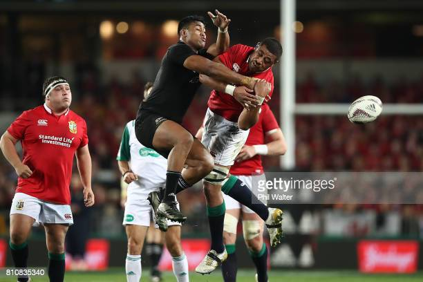 Julian Savea and Taulupe Faletau of the Lions contest the ball during the Test match between the New Zealand All Blacks and the British Irish Lions...