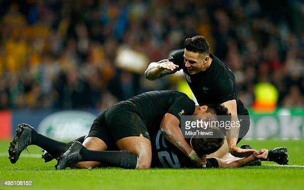 Julian Savea of New Zealand and Sonny Bill Williams of New Zealand celebrate with try scorer Beauden Barrett of New Zealand during the 2015 Rugby...
