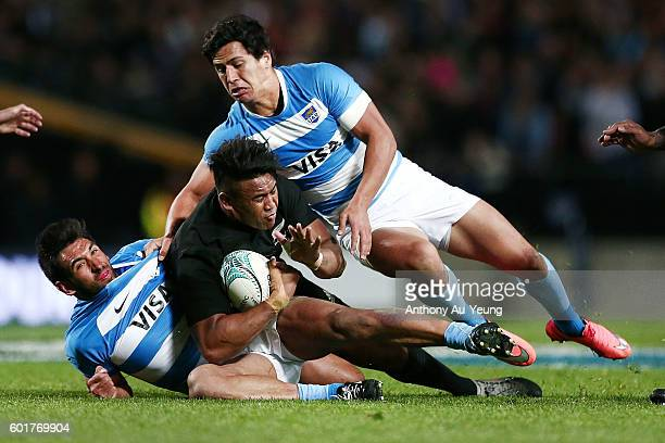 Julian Savea of New Zealand is tackled by Matias Orlando and Matias Moroni of Argentina during the Rugby Championship match between the New Zealand...