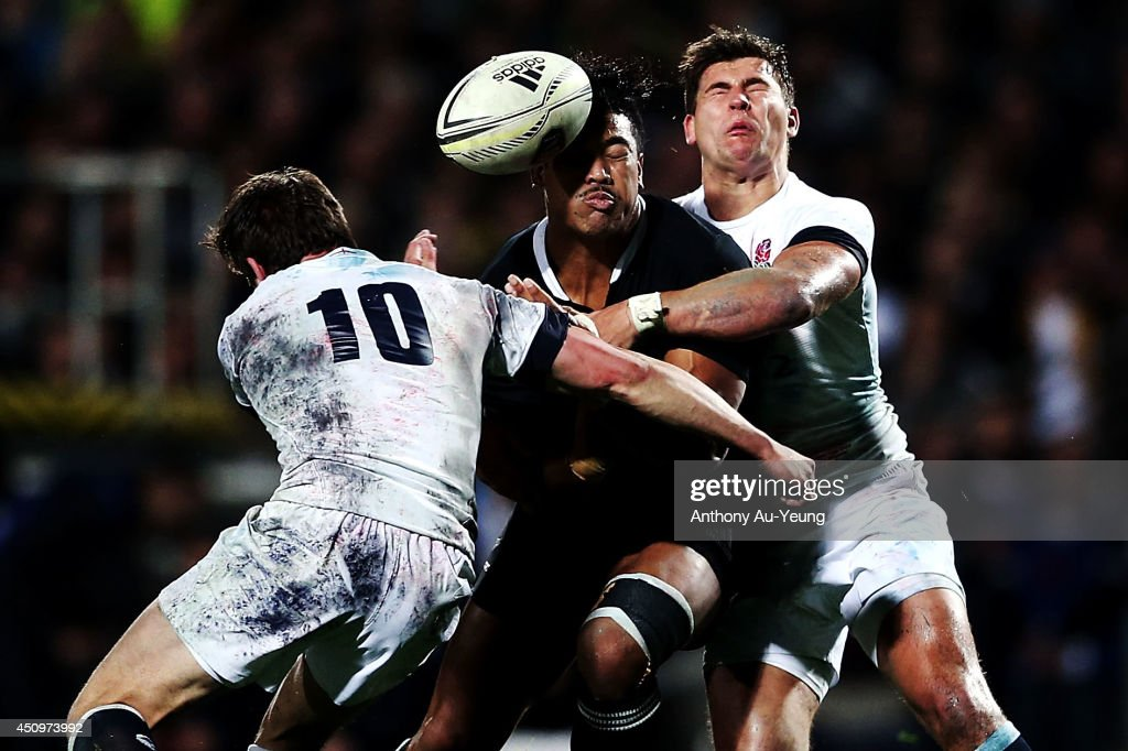 Julian Savea of New Zealand loses the ball in the tackle from Ben Youngs and Freddie Burns of England during the International Test match between the New Zealand All Blacks and England at Waikato Stadium on June 21, 2014 in Hamilton, New Zealand.
