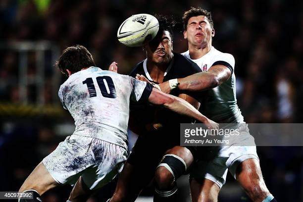 Julian Savea of New Zealand loses the ball in the tackle from Ben Youngs and Freddie Burns of England during the International Test match between the...