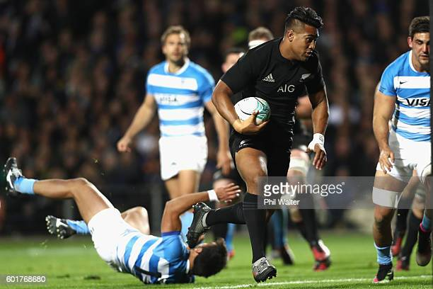 Julian Savea of the All Blacks breaks through the tackle of Matias Orlando of Argentina to score a try during the Rugby Championship match between...