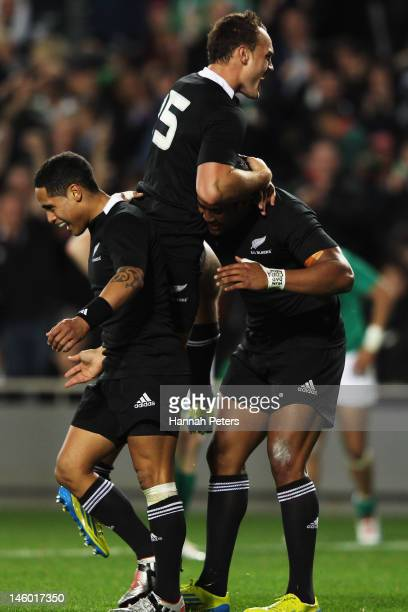 Julian Savea of the All Blacks celebrates with Israel Dagg and Aaron Smith after scoring a try during the International Test Match between the New...