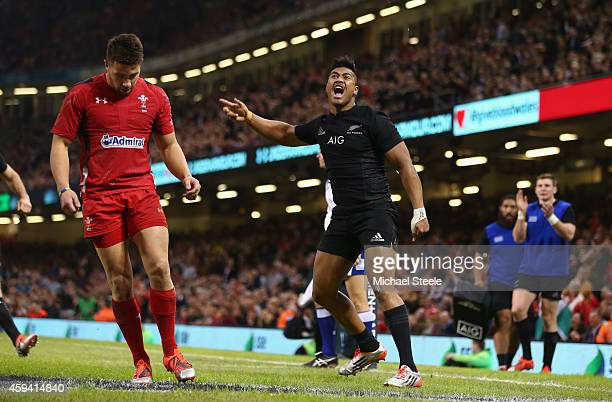 Julian Savea of the All Blacks celebtates scoring his sides opening try during the International match between Wales and New Zealand at the...