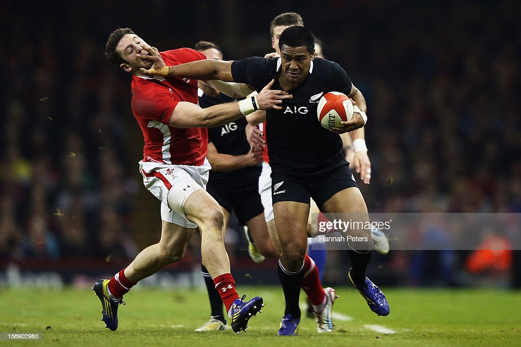 <a gi-track='captionPersonalityLinkClicked' href=/galleries/search?phrase=Julian+Savea&family=editorial&specificpeople=5780264 ng-click='$event.stopPropagation()'>Julian Savea</a> of the All Blacks fends off <a gi-track='captionPersonalityLinkClicked' href=/galleries/search?phrase=Alex+Cuthbert&family=editorial&specificpeople=6143846 ng-click='$event.stopPropagation()'>Alex Cuthbert</a> of Wales during the international match between Wales and New Zealand at Millennium Stadium on November 24, 2012 in Cardiff, Wales.